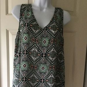 Cute sleeveless top. Back has cut out opening